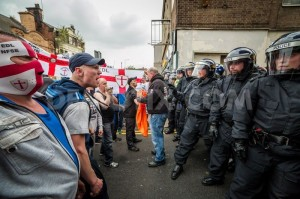 masked EDL members hurl abuse at police